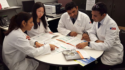 FDU Pharmacy Candidates Vidhi Patel, Amy Huang, Vishnu Patel and Ankit Patel pore over materials during their APPE rotations at BD Headquarters.